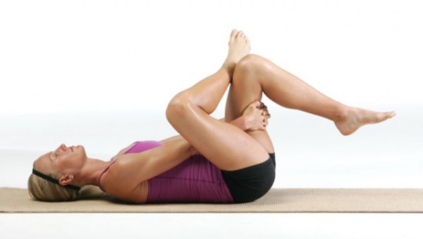 Woman demonstrating figure 4 stretch.