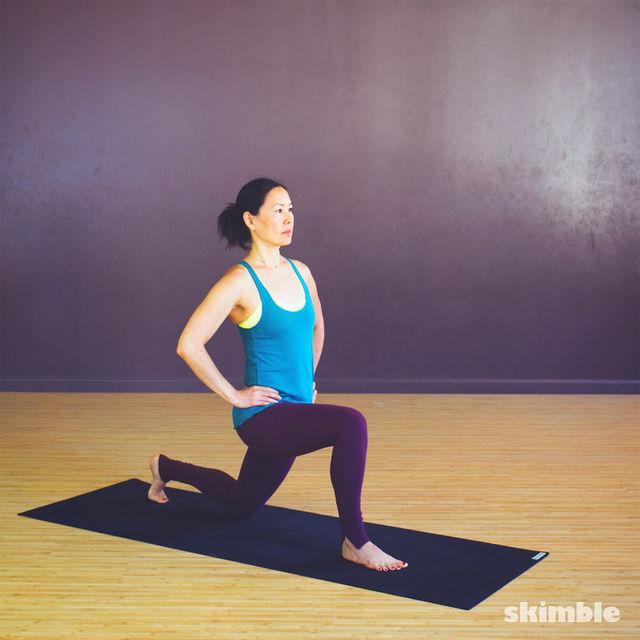Woman on one knee stretching hip flexor.