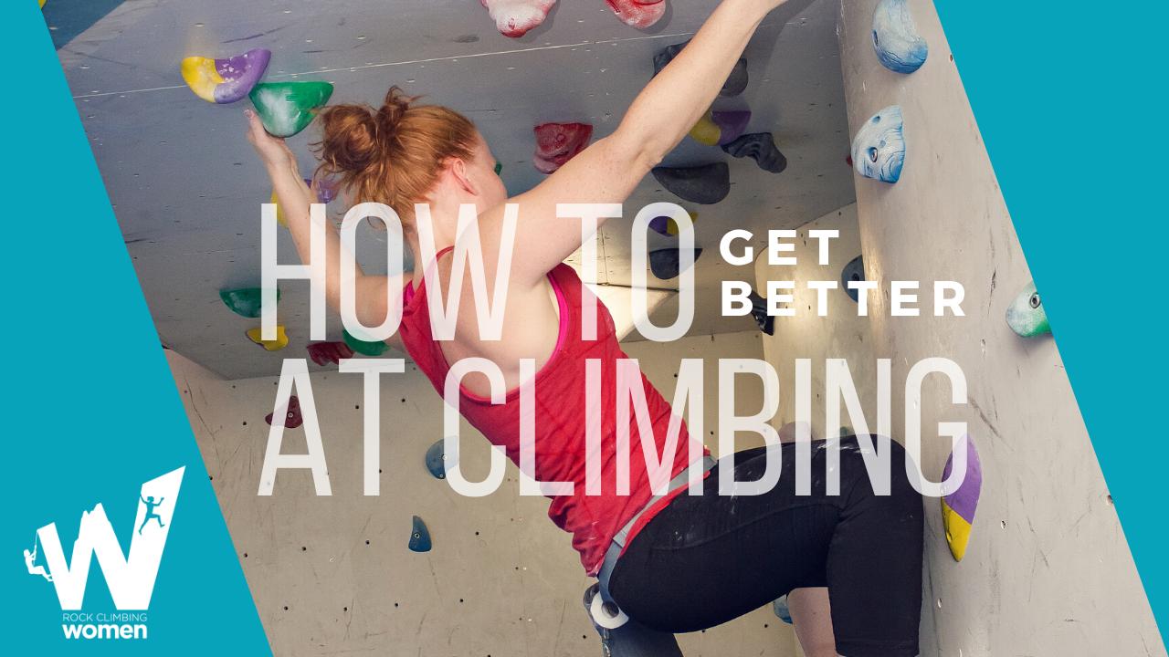 Woman climbing a rock climbing wall.