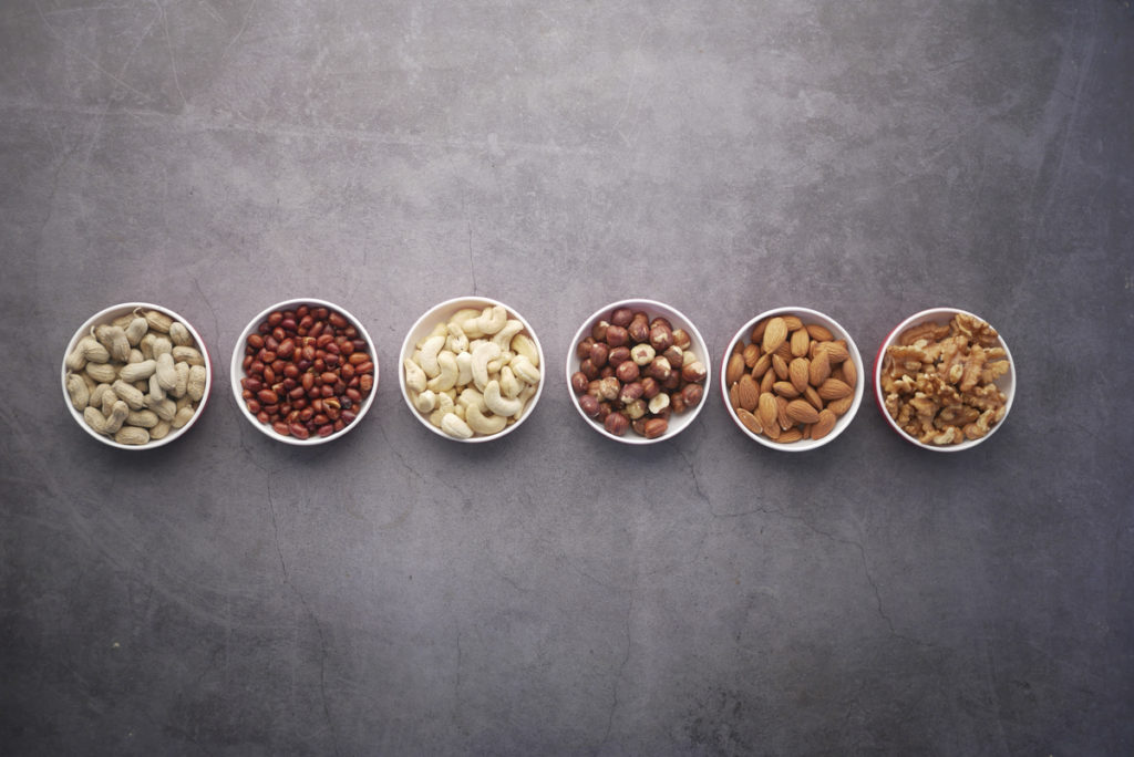 Line of nuts in bowls